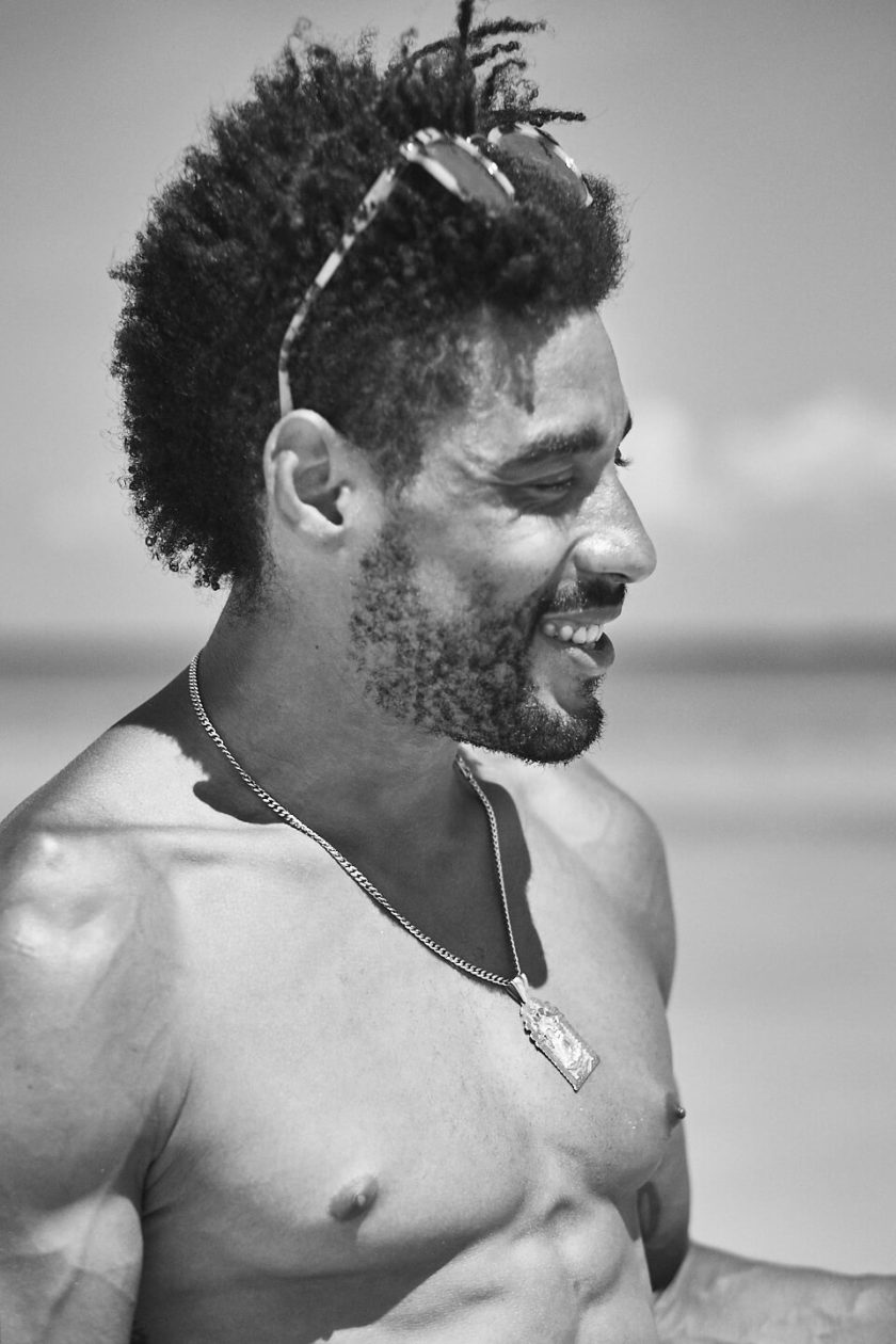 Fuji X Pro2 with xf 56mm f1.2 - Model smiling on the beach. Playa del Carmen, Mexico - Model: Marquis