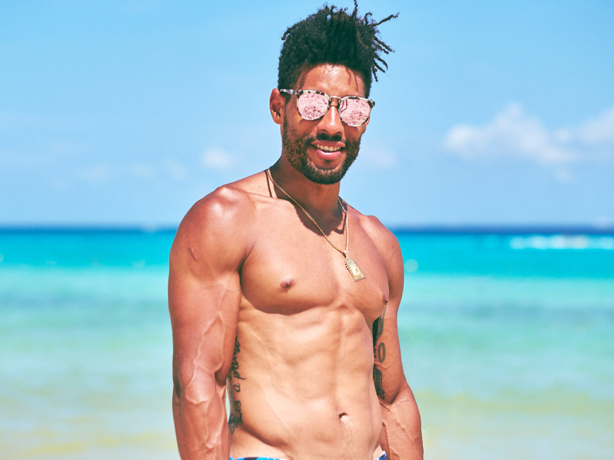 Fuji X Pro2 with xf 56mm f1.2 - Model wearing sunglasses on the beach. Playa del Carmen, Mexico - Model: Marquis