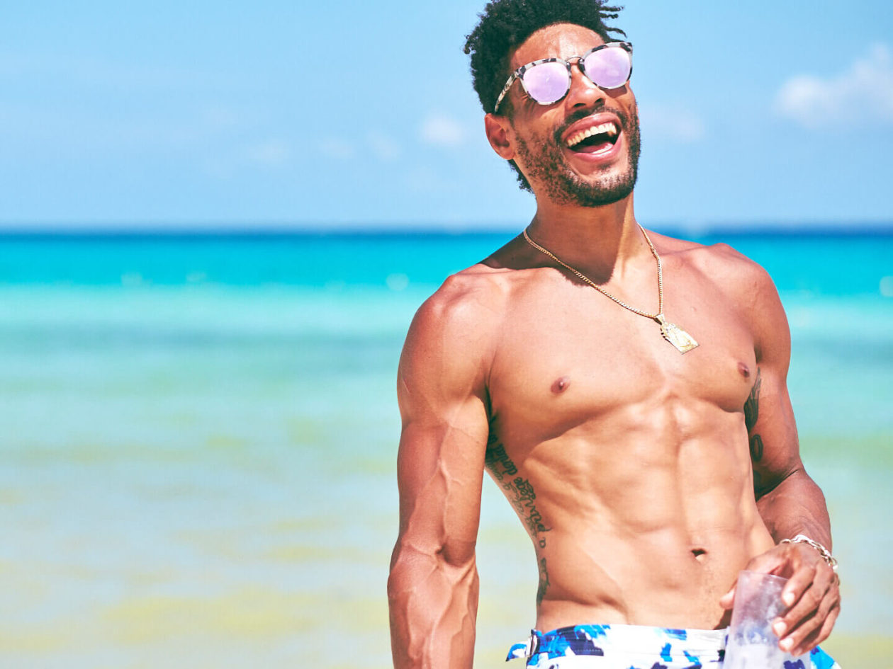 Fuji X Pro2 with xf 56mm f1.2 - Model wearing sunglasses laughing on the beach - Lifestyle Photography in Playa del Carmen, Mexico - Model: Marquis