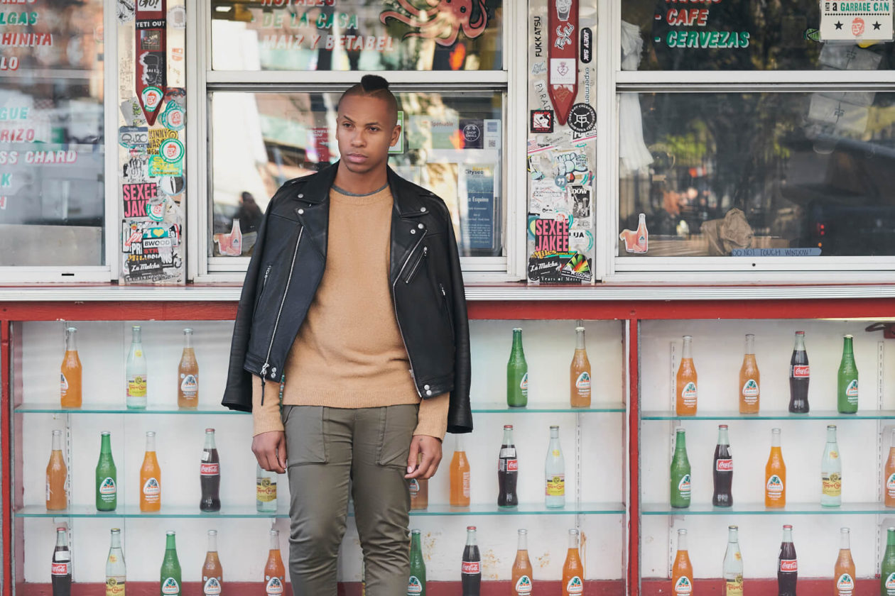 Fuji X Pro2 with xf 56mm f1.2 - Frank and Oak Men's Fashion Photography in SoHo New York with male standing next to restaurant store front - Model: Rashad