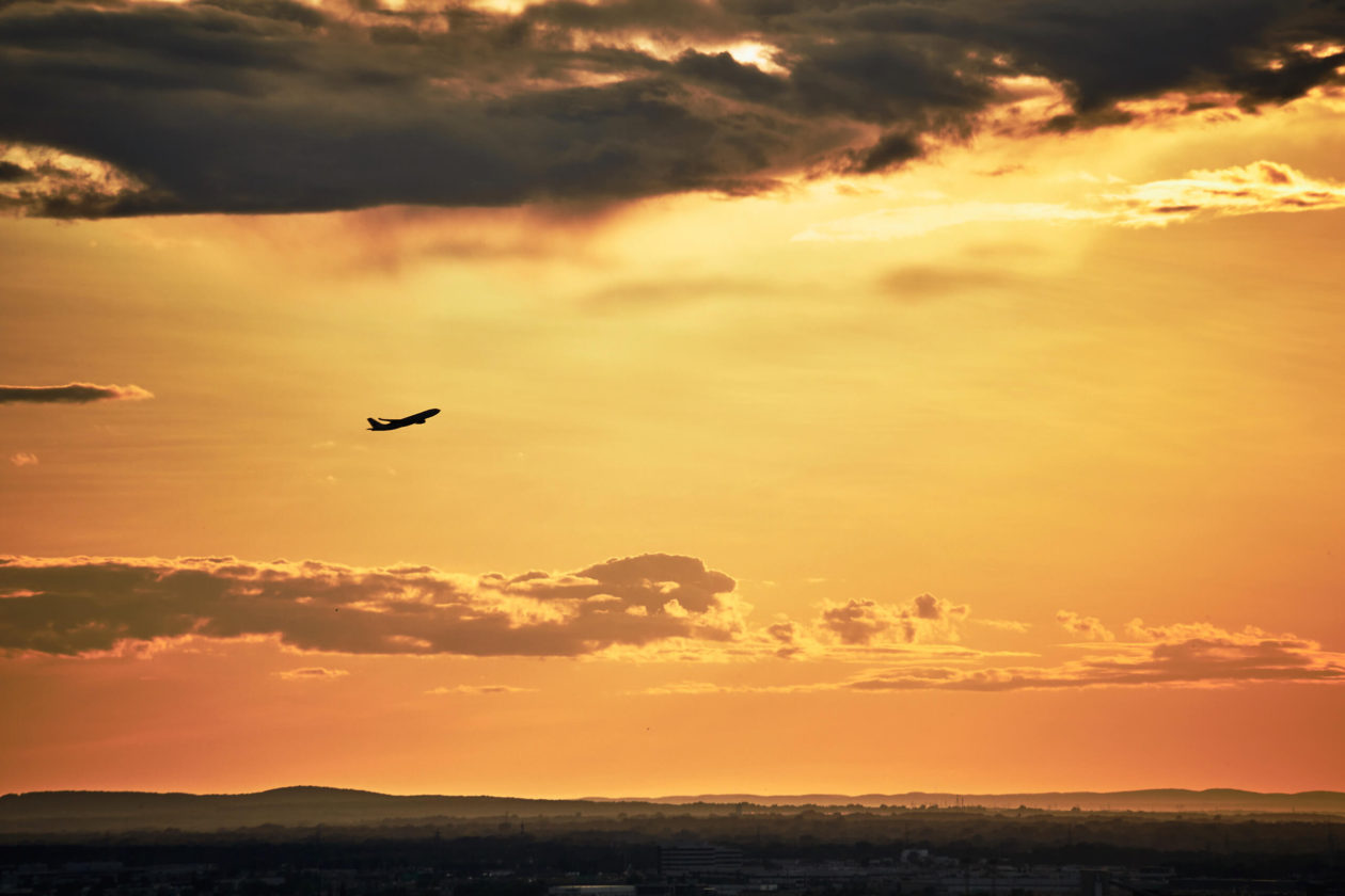 Canon 5D Mark iii with 70-300mm 4/5.6 - Golden hour sunset on Balcony in Montreal with airplane in the sky