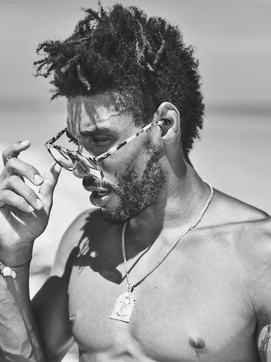 Fuji X Pro2 with xf 56mm f1.2 - Black and White model wearing sunglasses on the beach. Playa del Carmen, Mexico - Model: Marquis