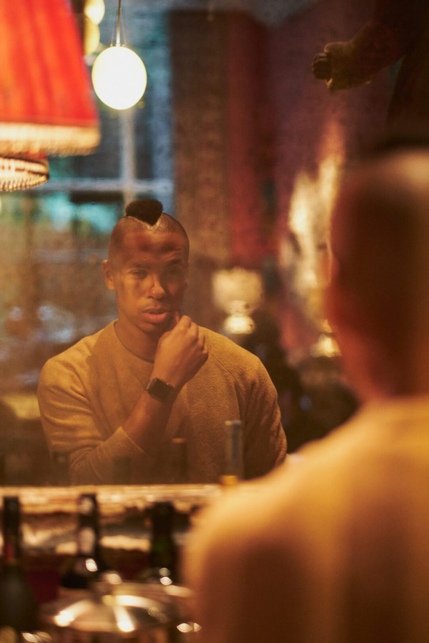 Fuji X Pro2 with xf 56mm f1.2 - Frank and Oak Lifestyle Men's Fashion Photography in SoHo New York looking through a mirror - Model: Rashad
