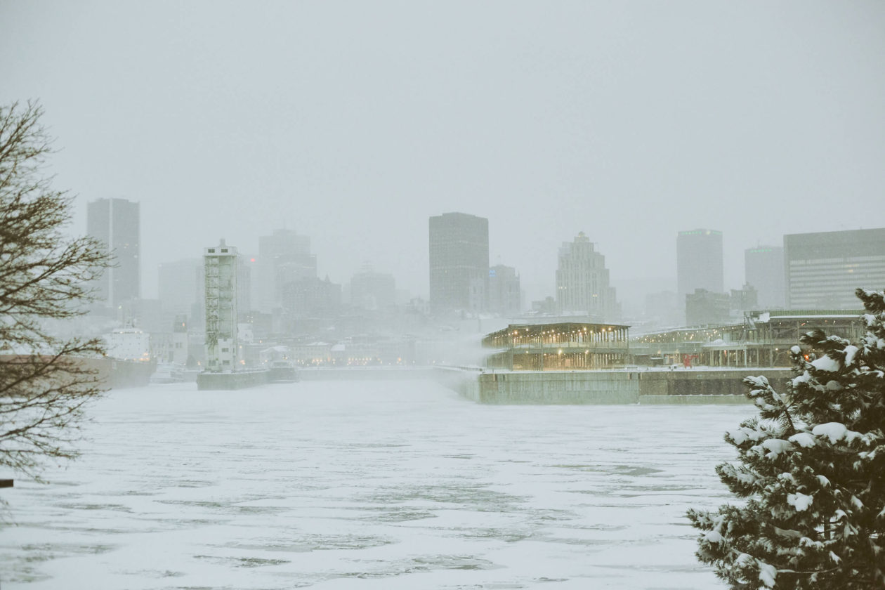 Canon 5D Mark iii with ef 50mm 1.8 - Landscape Photography - A frozen river view of Old Port Downtown Montreal during the winter